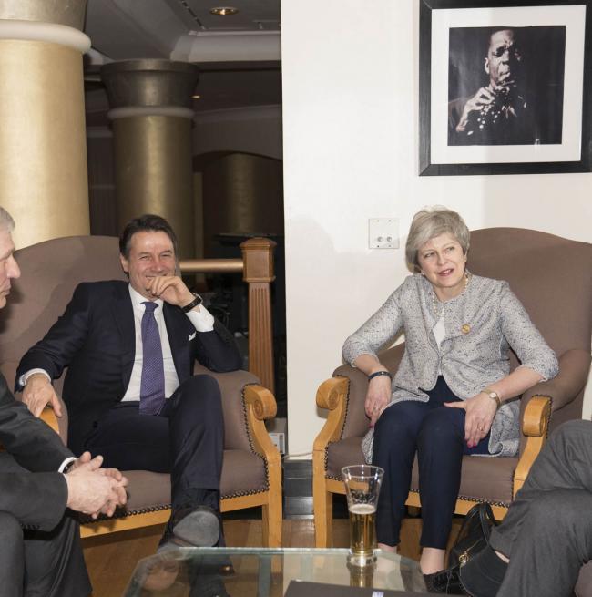 Il Presidente Conte con il Primo Ministro britannico, Therasa May