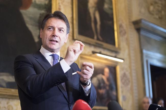 Conte durante il punto stampa a Palazzo Marino